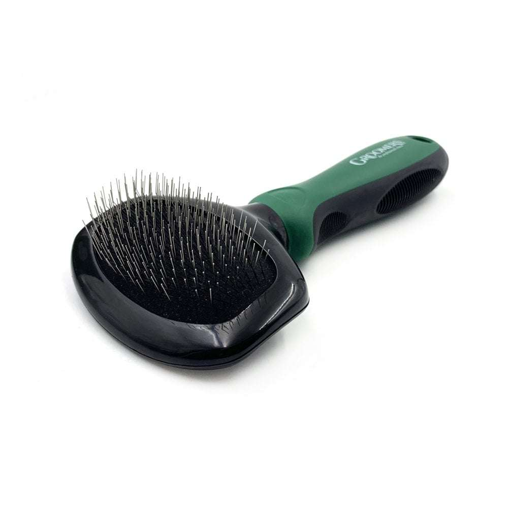 A slicker brush used in dog grooming